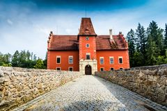 Cervena Lhota - the red, water chateau in the the Czech republic. The red, water chateau in the the Czech republic - Cervena Lhota stock photo