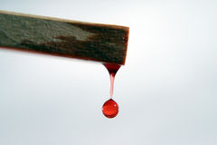 Red Water Drop Off Wood. Water drop falling stock images