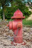 Red water hydrant in the park. Red water hydrant with corrosion in the park Royalty Free Stock Photos