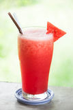 Red water melon fruit juice frappe. With green bokeh background Stock Image