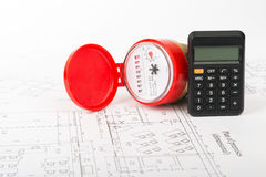 Red water meter with calculator Stock Photo