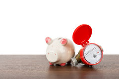 Red water meter with piggy bank Stock Photo