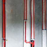 Red water pipes Royalty Free Stock Image