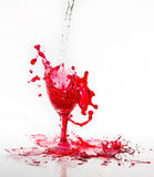 Red water spill from a broken wine glass on a white background. Red water spill from a broken wine glass on white background Stock Image