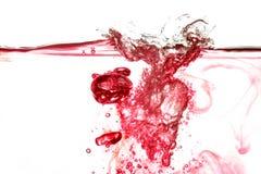 Red Water Splash Stock Image