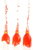 The Red water that spread out from the Three bottle. Stock Images