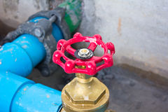 Red water valve. Stock Photography