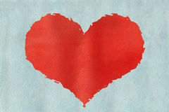 Red watercolor grunge heart on watercolor light blue background. Stock Photography