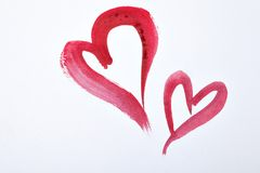 Red watercolor hearts on white paper. St. Valentine`s Day Stock Photos