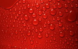 Red waterdrops. Waterdrops on red background from above royalty free stock photo