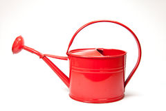 Red watering can. Isolated on white background Stock Image