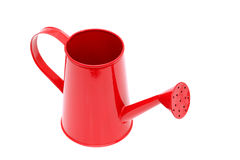 Red watering can. Closeup of the spout of a red watering can Stock Image