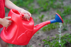 Red watering-can Stock Photo