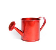 Red watering can. On the white background. The watering can made ​​of metal Stock Images