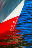 Red waterline on a ship. White and red load water-line with scale of numbers Royalty Free Stock Images