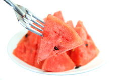 Red watermelon impaled on a fork Stock Photos