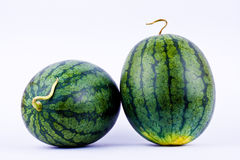 Red Watermelon rind on the outside is green and beautiful striped. Watermelon rind on the outside is green and beautiful striped royalty free stock photos