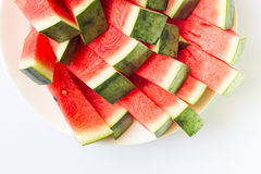 Red watermelon. Watermelon slices on a white plate Stock Image