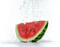 Red watermelon with splash of water Stock Photo
