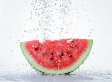 Red watermelon with splash of water Royalty Free Stock Image