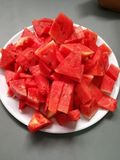 Red watermelon is sweet juicy and watery. Thirst quencher : a watermelon as widely known. A tropical fruit with red fluffy flesh inside, but green and hard peel Stock Photos