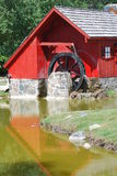 Red watermill by stream Royalty Free Stock Photo