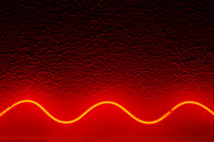 Red Waved Neon Lamp. Royalty Free Stock Image