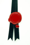 Red wax seal black ribbon. Round red wax seal on black ribbon stock images