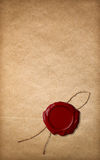 Red wax seal on old paper Stock Photo