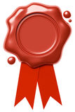 Red wax seal on red ribbon  on white Royalty Free Stock Images