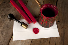 Red wax staff with stamp and letter. Red wax staff with stamp, pot and letter Royalty Free Stock Photo