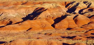 Red weathered hills at sunset. Red painted desert type of terrain in Petrified Forest N.P. in Arizona. Captured at sunset Royalty Free Stock Photography