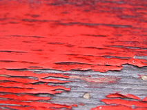 Red Weathered Paint. A closeup perspective of red weathered paint from a 100 year old wagon Royalty Free Stock Images