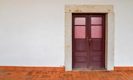 Red weathered wooden doors captured in Lisbon, Portugal. Red weathered wooden doors - Lisbon, Portugal stock photography