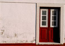 Red weathered wooden doors captured in Lisbon, Portugal. Red weathered wooden doors - Lisbon, Portugal stock images
