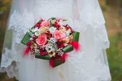 Red wedding bouquet. Bride with a red wedding bouquet Royalty Free Stock Image