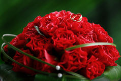 Red wedding bouquet. On a green background Royalty Free Stock Image