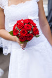 Red wedding bouquet in bridal hands Stock Photo