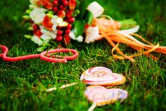 Red wedding bouquet. On green grass Stock Photo