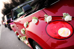 Wedding car. A red wedding car with flowers Royalty Free Stock Photos