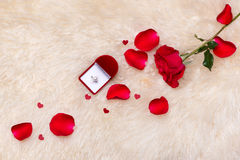 Red wedding decoration with rings and roses. Royalty Free Stock Image