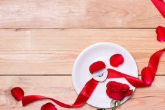 Red wedding decoration with rings and roses. Stock Photography