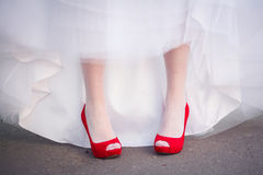 Red wedding shoes. Wedding shoes red women on the green grass in style Stock Photo