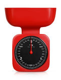 Red weighing scales Stock Images