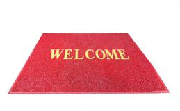 Red welcome carpet, mat threshold. Doormat isolated on white background stock photography