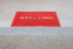 Red welcome carpet on staircase.  royalty free stock images