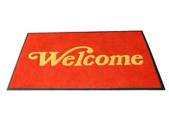 Red Welcome Mat. Red Door Mat With Welcome In Gold Letterings Isolated On White Background royalty free stock image