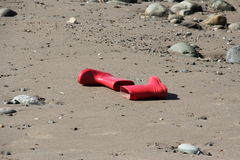 Red wellies. A pair of childrens wellies abandoned on the beach Royalty Free Stock Photos