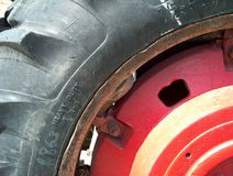 Red Wheel. Old tractor tire and red wheel still working Royalty Free Stock Photography