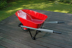 Red wheel barrow 1. A sparkling new red wheel barrow Royalty Free Stock Photography